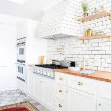 subway tiled kitchen range hood transitional kitchen