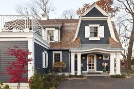 sand paint color exterior traditional with eyebrow roof gates