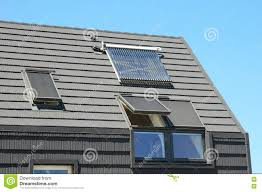 modern house roof with solar water heater solar panels and