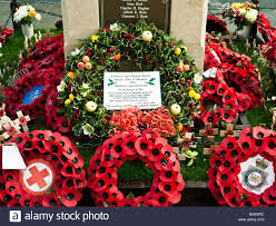 war memorial in wootton bassett with poppy wreaths wreath