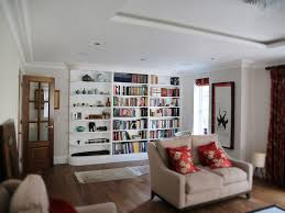 white curved built in shelving unit bespoke furniture fitted