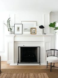 mirror above fireplace mantel over regal white also large wood