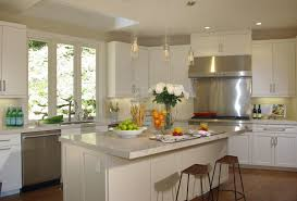 small kitchen with glass pendant lights and kitchen table also
