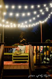 hang string lights on your deck an easy way deck decorating