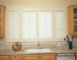 kitchen window shutters interior plantation shutters in kitchen around the house ideas