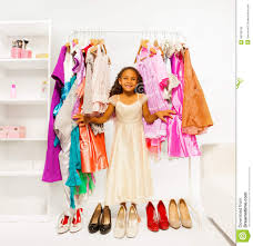 Small Beautiful Pics Beautiful Small Choosing Clothes In The Shop Stock Photo