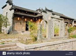 old traditional style chinese brick house with carved eaves stock