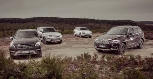 maroon range rover suv comparison bmw x5 v mercedes benz ml class v range rover