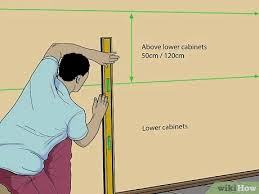 how to hang a cabinet to the wall how to install cabinets with pictures wikihow