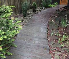 paver boulder retaining bordered paver stepping stone walkway by
