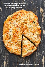 buffalo chickpea pizza with white garlic sauce and celery ranch
