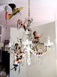 From A Chandelier More New Artwork The Copper Queen Barbie U0027s Hanging From The