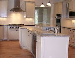 White Kitchen Cabinet Door by Dura Supreme Kitchen Cabinetry Shown With Arcadia Panel Cabinet