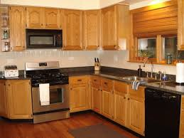 golden oak cabinets with wood floors outofhome