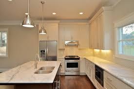white l shaped kitchen with island white granite countertops transitional kitchen natalie hager