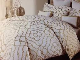 gold and white bedding on the hunt