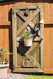 Hinges For Barn Doors by Custom Barn Door Fence Decor With Plant Hanger Old Hinges And