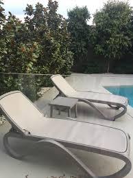 nardi omega sun loungers in tortora with rodi side table