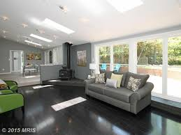 contemporary living room with high ceiling u0026 skylight in