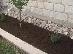 Designing Flower Beds Placing Rocks Between The Wall And The Flower Beds Keep The Plants