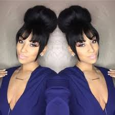 curly hair in high bun with bang faux bang effect on natural hair those beautiful tresse