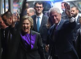 hillary clinton picks a symbolic pop of purple to punctuate her