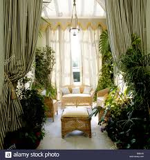 Fabric Drapes View Into A Conservatory With Fabric Drapes And Plants Stock Photo