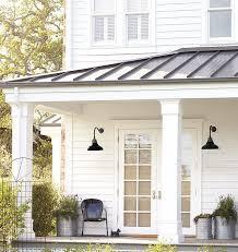 white exterior light fixtures white exterior siding ideas metal roof lanterns and planters