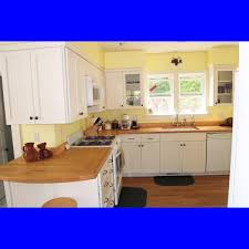 interesting white wooden kitchen cabinets with glass door with