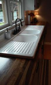 Small Farmhouse Sink  Cast Iron New From Strom Plumbing - Cast iron kitchen sinks with drainboard