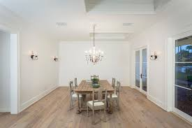 rustic dining room with hardwood floors doors in