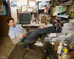 garage office hispanic mechanic in garage office stock photo getty images