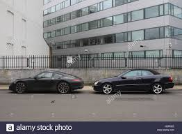 mercedes commercial porsche and mercedes cars parked outside a grey commercial