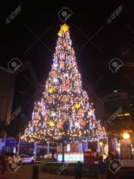 big tree decorated with lights stock photo picture and