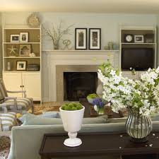 French Country Living Room by Classic White Fireplace Trim Line And Glass Flowers For French