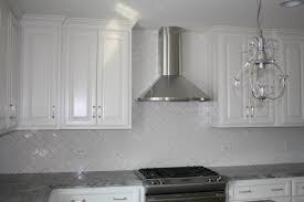 white herringbone glass tile kitchen backsplash and artistic