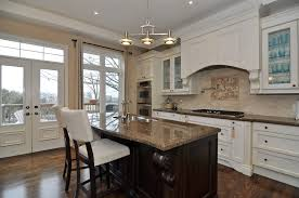 White Kitchen Dark Floors by White Lacquered Wood Cabinet Hardware Stainless Steel Curved