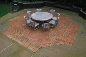 terrace simple patio brick patterns ideas with round table and