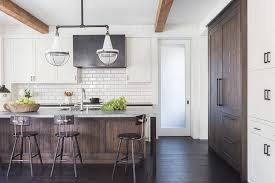 Vintage Galley Kitchen - galley kitchen with dark stained plank ceiling transitional
