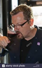 purple cocktail eddie izzard drinks a purple cocktail stock photo royalty free