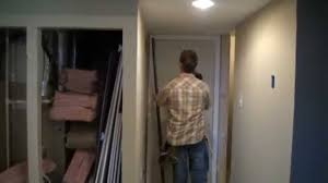 how to cut basement doors to fit in areas with low ceilings youtube