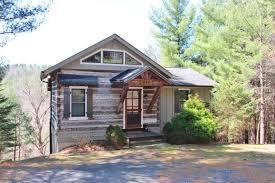furnished riverfront antique log cabin