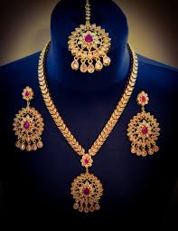 red necklace earring set images Long gold plated gold and red necklace earrings tikka set indian jpeg
