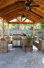 outdoor patio with peaked roof and fans design outdoor