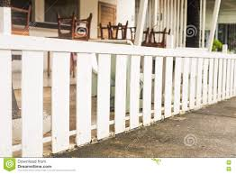 white wooden country style fence and small yard behind stock photo