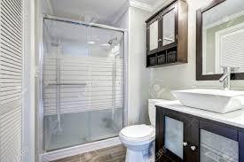 modern bathroom interior with glass door shower brown vanity