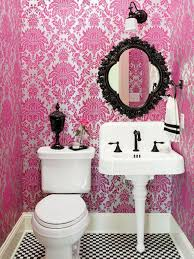 beautiful design of pink theme bathroom with classic mirror and