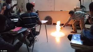 Chair Lifting Experiment Chemistry Teacher Wows Class By Setting The Floor On Fire In Video