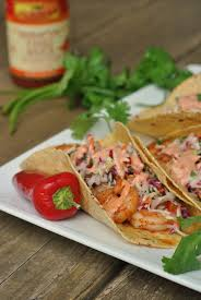 spicy sriracha shrimp tacos with cilantro slaw