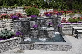 a formal water feature and landscape create the perfect